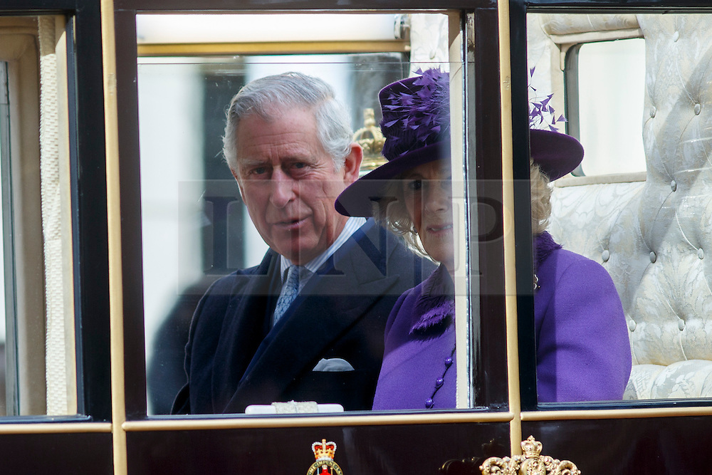 © Licensed to London News Pictures. 03/03/2015. LONDON, UK. Prince Charles and Duchess of Cornwall ride in a state carriage on their way to Buckingham Palace following a Ceremonial Welcome during Mexican President's state visit in central London on Tuesday, 3 March 2015. Photo credit : Tolga Akmen/LNP