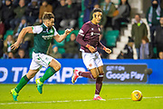 Sean Clare (#9) of Heart of Midlothian runs at Darren McGregor (#24) of Hibernian FC during the Ladbrokes Scottish Premiership match between Hibernian FC and Heart of Midlothian FC at Easter Road Stadium, Edinburgh, Scotland on 29 December 2018.