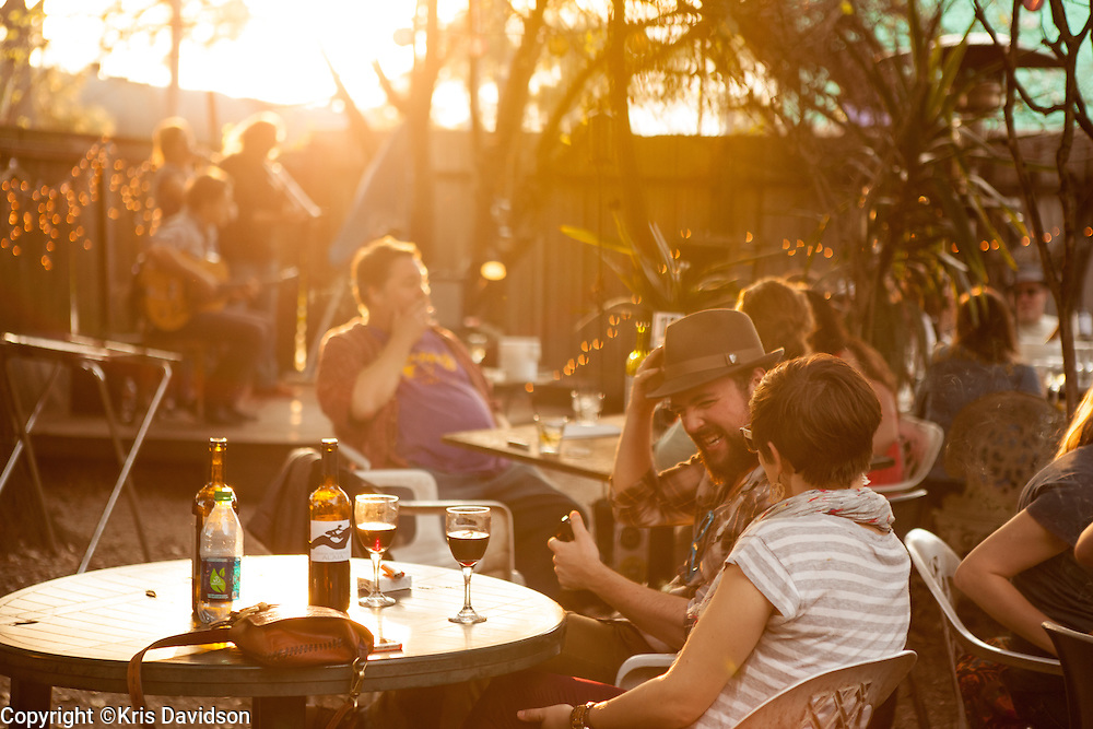Spencer Morin and Rachel Grundy enjoy good food, good jazz, good people in a relaxed backyard setting at Bacchanal.