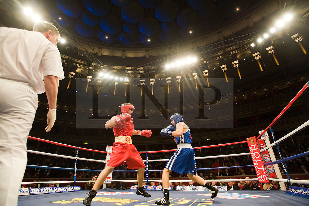 © Licensed to London News Pictures. London, UK  07/10/2011. JOSEPH CANALE, US Marine Corp (Left) Vs CHRIS SMITH, RAF (right). Members of the UK and US Armed Forces go head to head in the Royal Albert Hall cup boxing match. This is the first time a boxing event has taken place in the historic venue following a court ruling banning the use of the hall for boxing and wrestling in 1999. The Court of Appeal subsequently overturned the decision earlier this year. The venue has hosted some of the greatest names in British boxing including Sir Henry Cooper, Frank Bruno, Lennox Lewis and Prince Naseem Hamed. Photo credit: Ben Cawthra/LNP
