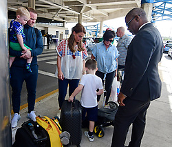 EXCLUSIVE: *NO WEB UNTIL 1200PM BST MAY 23* Wayne and Coleen Rooney and family arrives at Grantley Adams International airport in Barbados. One of the couple's sons is spotted with a red eye as Coleen pushed him in a stroller. 17 May 2018 Pictured: Wayne Rooney and family. Photo credit: MEGA TheMegaAgency.com +1 888 505 6342