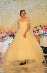 November 17, 2018 - Madiun, East Java, Indonesia - A model demonstrates the Wedding Gown at night Magnificent Wedding Exhibition 2018 in one of the hotels in Madiun. (Credit Image: © Ajun Ally/Pacific Press via ZUMA Wire)