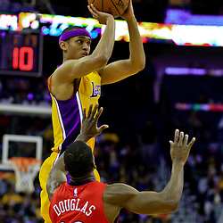 Apr 8, 2016; New Orleans, LA, USA; Los Angeles Lakers guard Jordan Clarkson (6) shoots over New Orleans Pelicans guard Toney Douglas (16) during the second quarter of a game at the Smoothie King Center. Mandatory Credit: Derick E. Hingle-USA TODAY Sports
