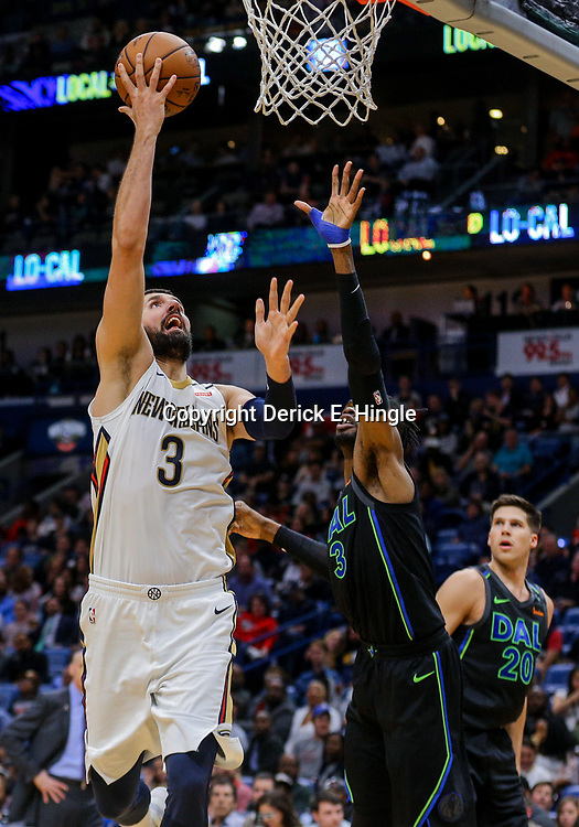 Mar 20, 2018; New Orleans, LA, USA; New Orleans Pelicans forward Nikola Mirotic (3) shoots over Dallas Mavericks center Nerlens Noel (3) during the second half at the Smoothie King Center. Pelicans defeated the Mavericks 115-105. Mandatory Credit: Derick E. Hingle-USA TODAY Sports