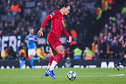 Liverpool defender Virgil van Dijk (4) in action during the Champions League match between Liverpool and Napoli at Anfield, Liverpool, England on 27 November 2019.