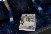 Metro newspaper on a London underground tube train seat with Olympic amabassador and rioter story on page 1.