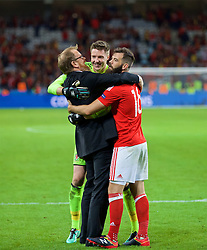 LILLE, FRANCE - Friday, July 1, 2016: Wales' head of international affairs Mark Evans, goalkeeper Wayne Hennessey and Joe Ledley celebrate after a 3-1 victory over Belgium and reaching the Semi-Final during the UEFA Euro 2016 Championship Quarter-Final match at the Stade Pierre Mauroy. (Pic by David Rawcliffe/Propaganda)