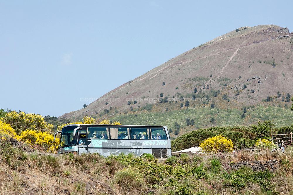 29 May 2017, Parco Nazionale del Vesuvio, Naples Italy - A bus of tourists come back from the cone of volcano Vesuvius on the Street of Vesuvio.