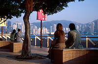 Couples share a quiet moment on the Promenade in Kowloon, Hong Kong, China.