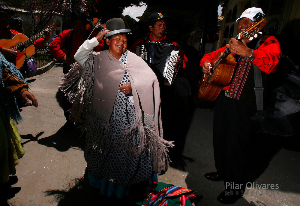 A woman dances as she celebrates the Day of Skulls at the General Cemetery in La Paz November 8, 2009. Bolivians who keep close relatives' skulls at home as a macabre talisman flock to the cemetery chapel once a year to have the craniums blessed and to bring themselves good luck in the future.