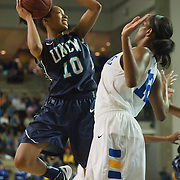 01/12/12 Newark DE: University of North Carolina Wilmington Sophomore Guard Abria Trice #10 attempts a shot under the basket while Delaware Forward #12 Danielle Parker (Right) defends during a Colonial Athletic Association Conference Basketball Game against The Fightin Blue Hens Thursday, Jan. 12, 2012 at the Bob Carpenter Center in Newark Delaware.