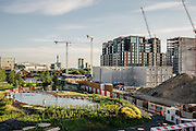 After 150 years of industrial use, the area to the north of King's Cross station is being transformed into a vibrant new city quarter.  A new development is the King's Cross Pond Club which has now opened its outdoor swimming pool to the public. The 40 metre fresh water public bathing pond is the first of its kind in the UK. It is purified using submerged plants to filter the water and is surrounded by flowers and plants.