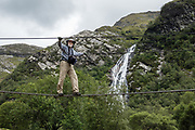 Steall Waterfall in the valley of Glen Nevis near Fort William, Scotland, United Kingdom, Europe. Steall Falls is Scotland's second highest waterfall, with a single drop of 120 meters or 393 ft. One of the best short hikes in Scotland ascends 220 m to the falls (3.5 km / 2.25 miles round trip) via Nevis Gorge, an area owned by the John Muir Trust, which is attempting to restore wilderness here after centuries of burning and grazing.