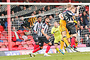 Grimsby Town defender Nathan Clarke (5) heads the ball towards goal as Port Vale goalkeeper Ryan Boot (23) looks on during the EFL Sky Bet League 2 match between Grimsby Town FC and Port Vale at Blundell Park, Grimsby, United Kingdom on 10 March 2018. Picture by Mick Atkins.