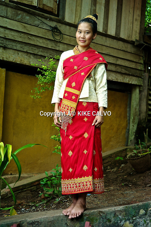 Teen girl wearing a Lao Lom wedding dress.