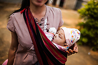 A young mother and child at the opening ceremony for the JE vaccination campaign in Xieng Khouang province, Laos.
