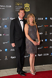 LIVERPOOL, ENGLAND - Tuesday, May 6, 2014: Former Liverpool player Gary Gillespie and his wife arrive on the red carpet for the Liverpool FC Players' Awards Dinner 2014 at the Liverpool Arena. (Pic by David Rawcliffe/Propaganda)