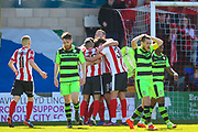 Lincoln City celebrate the own goal by Forest Green Rovers midfielder Marcus Kelly (10) as the score goes to 2-1 during the Vanarama National League match between Lincoln City and Forest Green Rovers at Sincil Bank, Lincoln, United Kingdom on 25 March 2017. Photo by Simon Davies.