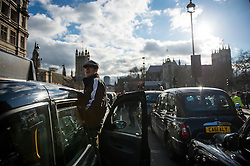 © Licensed to London News Pictures. 10/02/2016. London, UK. London black cab drivers stage a protest in Westminster, London against Government interference in the taxi industry and 'active support' for Uber, which they allege is a 'tax avoiding global corporation' Photo credit: Ben Cawthra/LNP