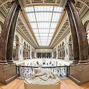 Sculpture and columns at the Royal Museums of Fine Arts in Belgium (in French, Musées royaux des Beaux-Arts de Belgique), one of the most famous museums in Belgium. The complex consists of several museums, including Ancient Art Museum (XV - XVII century), the Modern Art Museum (XIX  XX century), the Wiertz Museum, the Meunier Museum and the Museé Magritte Museum.