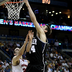 Mar 24, 2011; New Orleans, LA; Butler Bulldogs center Andrew Smith (44) is defended by Wisconsin Badgers forward Jon Leuer (30) during the first half of the semifinals of the southeast regional of the 2011 NCAA men's basketball tournament at New Orleans Arena.  Mandatory Credit: Derick E. Hingle