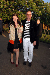 GILES DEACON and KATIE GRAND at the annual Serpentine Gallery Summer Party in association with Swarovski held at the gallery, Kensington Gardens, London on 11th July 2007.<br />