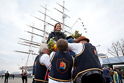© Licensed to London News Pictures. 01/04/2013. London, UK. Michelle Wlochowski of Connecticut, USA, is lifted into the air on a chair by members of the Blackheath Morris Men as part of an Easter ritual in Greenwich, London, today (01/04/2013).  The tradition, known as 'Easter Lifting', involves the lifting of a female volunteer into the air three times before being asked to kiss each of those doing the lifting.  Photo credit: LNP
