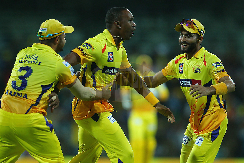 Dwayne Bravo of the Chennai Superkings celebrates the wicket of Suryakumar Yadav of the Kolkata Knight Riders with Suresh Raina of the Chennai Superkings  and Ravindra Jadeja of the Chennai Superkings  during match 28 of the Pepsi IPL 2015 (Indian Premier League) between The Chennai Superkings and The Kolkata Knight Riders held at the M. A. Chidambaram Stadium, Chennai Stadium in Chennai, India on the 28th April 2015.<br /> <br /> Photo by:  Ron Gaunt / SPORTZPICS / IPL