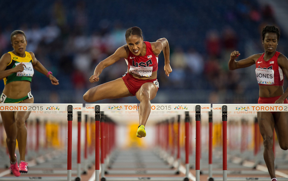 Queen Harrison, of the USA, in the 100 meter hurdles final during athletics competition at the 2015 PanAm Games in Toronto.