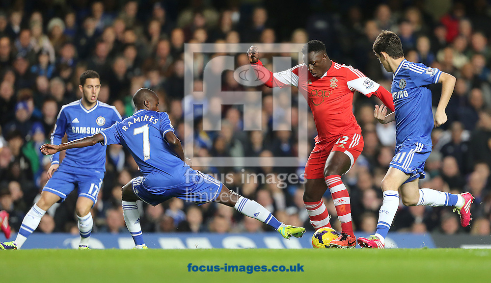 Picture by Richard Calver/Focus Images Ltd +447792 981244<br /> 01/12/2013<br /> Ramires of Chelsea tries to take the ball from Victor Wanyama of Southampton during the Barclays Premier League match at Stamford Bridge, London.