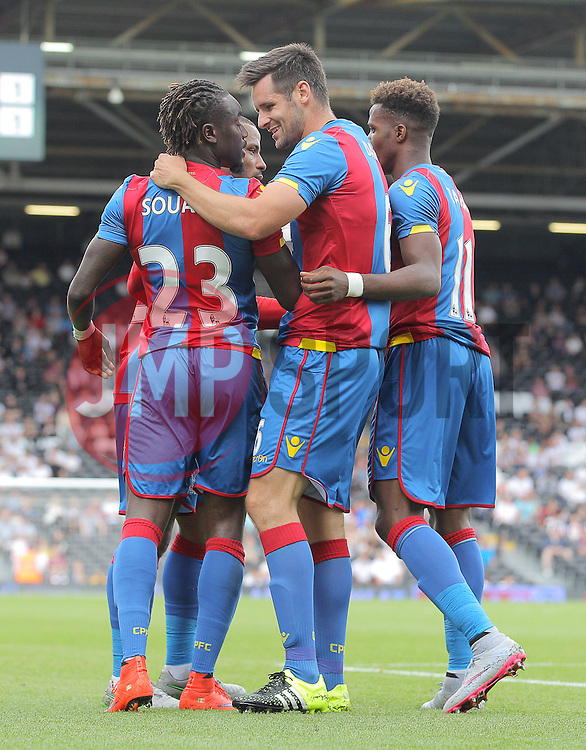 Pape Souare ( L ) of Crystal Palace celebrates with Scott Dann after he scores to make it 1-1 - Mandatory by-line: Paul Terry/JMP - 07966386802 - 01/08/2015 - SPORT - FOOTBALL - Fulham,England - Craven Cottage - Fulham v Crystal Palace - Pre-Season Friendly