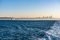 Looking back at Downtown Seattle, Washington, USA from a Washington State ferry on a cool clear Fall morning.