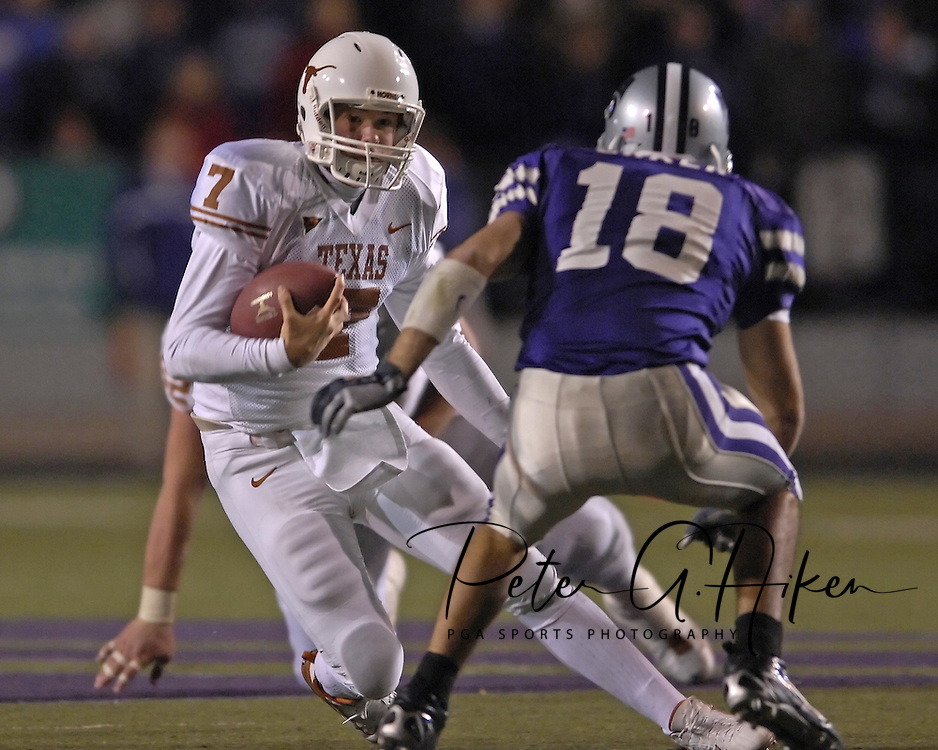 University of Texas quarterback Jevan Snead (7) rushes up field against pressure from Kansas State safety Andrew Erker (18) at Bill Snyder Family Stadium in Manhattan, Kansas, November 11, 2006.  The Wildcats upset 4th ranked Texas 45-42.<br />