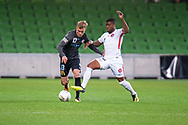 Melbourne City midfielder Nathaniel Atkinson (13) fights for the ball at the FFA Cup quarter-final soccer match between Melbourne City FC and Western Sydney Wanderers FC at AAMI Park in Melbourne.
