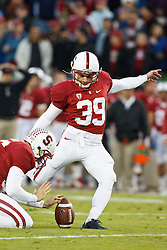 November 27, 2010; Stanford, CA, USA;  Stanford Cardinal kicker Nate Whitaker (39) kicks an extra point against the Oregon State Beavers during the first quarter at Stanford Stadium.  Stanford defeated Oregon State 38-0.