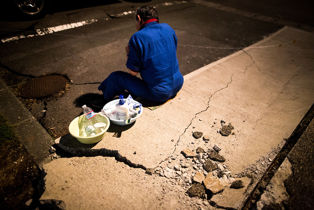 KUMAMOTO, JAPAN - APRIL 19: A man with his toiletries outside the Mashiki Town Gymnasium evacuation center on April 19, 2016 in Mashiki, Kumamoto, Japan. This is their fourth day in the evacuation center since magnitude-6.3 quake hit Kumamoto city.<br /> <br /> Photo: Richard Atrero de Guzman