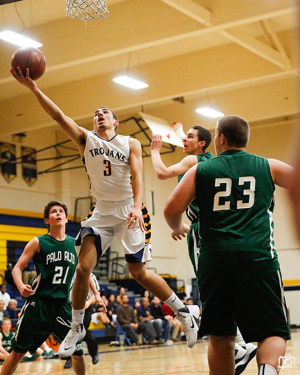 Milpitas guard Christian Rita (3) attacks the basket for a layup against Palo Alto at Milpitas High School in Milpitas, California, on January 31, 2014.  Milpitas beat Palo Alto 51-39. (Stan Olszewski/SOSKIphoto)
