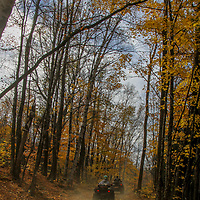 2 atv's going under small tree over trail in autumn season in New England, New England, NH, foliage, autumn, fall, trees, atv, utv, sxs, ohrv, orv, trail riding, hobby, adventure, sports, therapy, Click Stock Photography