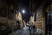 ROME, ITALY - 20 MARCH 2017: White LED street lamps with their glass panes removed light up a street in the Monti neighborhood in Rome, Italy, on March 20th 2017.<br /> <br /> Rome is undergoing a city-wide plan to change its public illumination from the current yellow sodium street lights CK to white LED lamps. In making the change, Rome joins a long line of cities around the world that have switched to the cheaper, and more environmentally friendly LED lighting, and it is not the first city where that change has come at the price of protest.<br /> <br /> Since July, some 100,000 led lights have already been installed, just over half the number that will be substituted in the 53 million euro changeover that is expected to save the city millions of euros in electrical bills. But when Rome's municipal electrical utility ACEA began to substitute the lamps in Rome's historic center, residents began to take note.