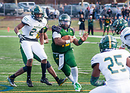 DelVal's Dashawn Darden (12) drives towards the end zone as Husson defenders surround him in the second quarter of the NCAA Division III playoffs Saturday, November 25, 2017 in Doylestown. DelVal defeated Husson 37-15 and move onto the quarterfinals.  (Photo by William Thomas Cain)