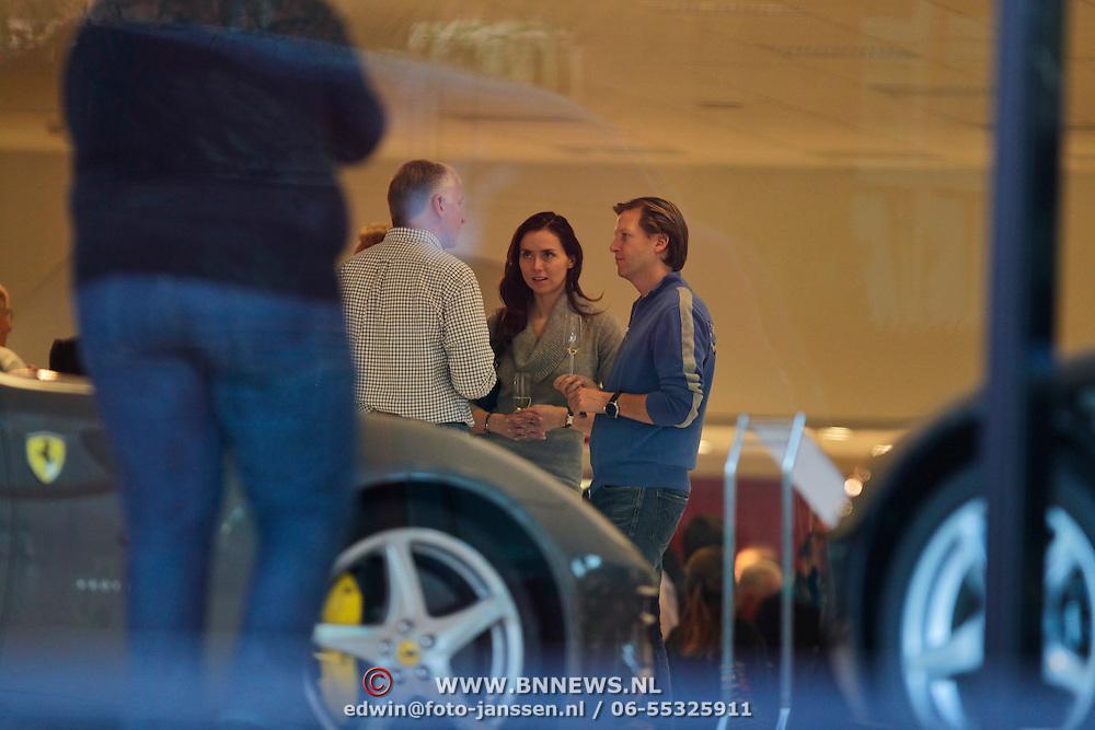 NLD/Hilversum/20111127 - Michiel Mol en partner malous Mens bij de presentatie van een nieuwe Ferrari