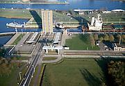 Nederland, Zeeuwsch-Vlaanderen, Terneuzen, 15/11/2001; zeeschip Kanin (uit een vd Baltische landen, geladen met erts / steenkolen) in de grote zeesluis in Terneuzen, begin Kanaal Terneuzen-Gent; de sluisdeuren (een operationeel, de tweede reserve) bevinden zich links en rechts voor de geopende brug (verzonken in het maaiveld) en worden bij sluiten naar de overzijde geschoven. Sluis. Sluizen.<br /> luchtfoto (toeslag), aerial photo (additional fee)<br /> photo/foto Siebe Swart