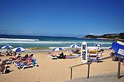 Australia, New South Wales, Sydney sunbathers at Bondi beach