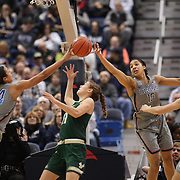 HARTFORD, CONNECTICUT- JANUARY 10: Ariadna Pujol #11 of the South Florida Bulls is blocked by Napheesa Collier #24 of the Connecticut Huskies and Gabby Williams #15 of the Connecticut Huskies during the the UConn Huskies Vs USF Bulls, NCAA Women's Basketball game on January 10th, 2017 at the XL Center, Hartford, Connecticut. (Photo by Tim Clayton/Corbis via Getty Images)