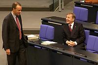 17 OCT 2003, BERLIN/GERMANY:<br /> Friedrich Merz (L), CDU, Stellv. CDU/CSU Fraktionsvorsitzender, und Wolfgang Clement (R), SPD, Bundeswirtschaftsminister, sind amuesiert, vor Beginn einer Bundestagsdebatte, Plenum, Deutscher Bundestag<br /> IMAGE: 20031017-01-017<br /> KEYWORDS: lacht, lachen, Gespraech, Gespäch