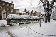 Dulwich Village homes landscape during mid-winter snow.