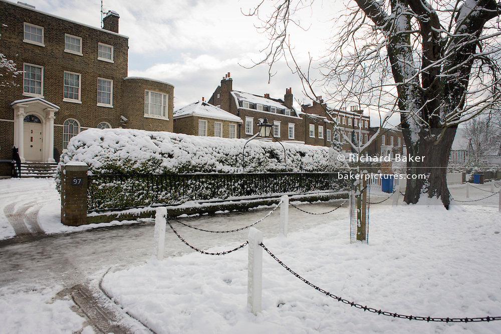 Dulwich Village homes landscape during mid-winter snow.