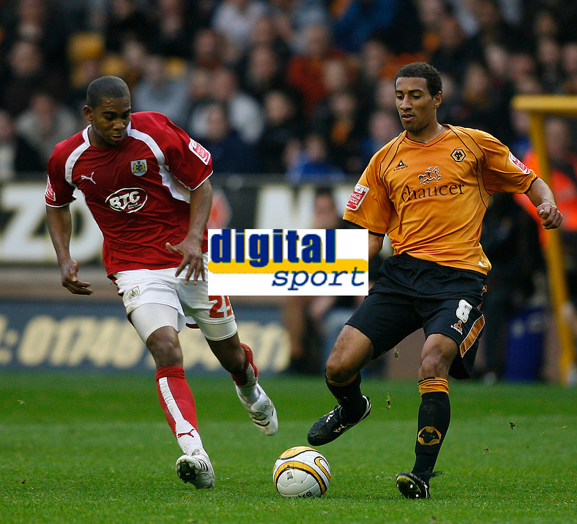 Photo: Steve Bond/Sportsbeat Images.<br /> Wolverhampton Wanderers v Bristol City. Coca Cola Championship. 03/11/2007. Karl Henry (R) lays the ball off as Marvin Elliott (L) closes in