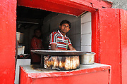 A man in his food stall. India, Jammu and Kashmir, Ladakh, Leh