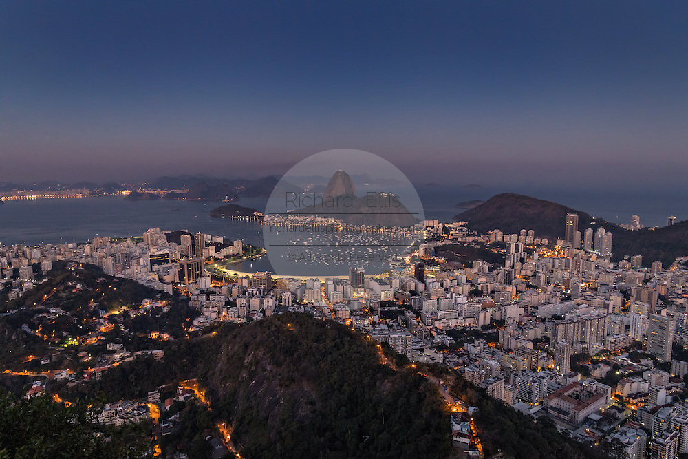 Sugarloaf Mountain and Guanabara Bay from Mirante Dona Marta in twilight in Rio de Janeiro, Brazil.